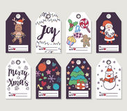 Christmas and New Year gift tags and cards. Hand drawn doodle design elements and calligraphy. Handwritten modern lettering Royalty Free Stock Image