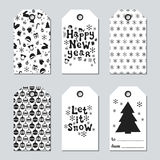 Christmas and New Year gift tags. Cards xmas set with hand drawing elements. Collection of holiday paper label in black. And white. Seasonal badge sale design Royalty Free Stock Photos