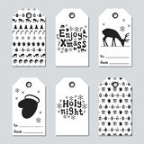 Christmas and New Year gift tags. Cards xmas set with hand drawing elements. Collection of holiday paper label in black. And white. Seasonal badge sale design Stock Photo