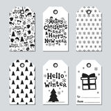 Christmas and New Year gift tags. Cards xmas set with hand drawing elements. Collection of holiday paper label in black. And white. Seasonal badge sale design Stock Images