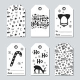 Christmas and New Year gift tags. Cards xmas set with hand drawing elements. Collection of holiday paper label in black. And white. Seasonal badge sale design Stock Image