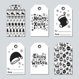 Christmas and New Year gift tags. Cards xmas set with hand drawing elements. Collection of holiday paper label in black. And white. Seasonal badge sale design Royalty Free Stock Image