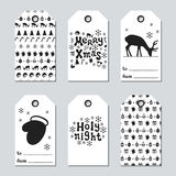 Christmas and New Year gift tags. Cards xmas set with hand drawing elements. Collection of holiday paper label in black. And white. Seasonal badge sale design Stock Photography