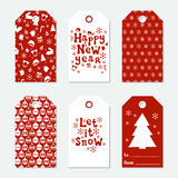 Christmas and New Year gift tags. Cards xmas set with hand drawing elements. Collection of holiday paper label in red. And white. Seasonal badge sale design Royalty Free Stock Image