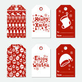 Christmas and New Year gift tags. Cards xmas set with hand drawing elements. Collection of holiday paper label in red. And white. Seasonal badge sale design Royalty Free Stock Photo