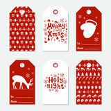 Christmas and New Year gift tags. Cards xmas set with hand drawing elements. Collection of holiday paper label in red. And white. Seasonal badge sale design Stock Photos