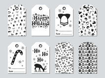 Christmas and New Year gift tags. Cards xmas set. Hand drawn elements. Collection of holiday paper label in black and. White. Seasonal badge sale design stock illustration