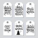Christmas and New Year gift tags. Cards xmas set. Hand drawn elements. Collection of holiday paper label in black and. White. Seasonal badge sale design Royalty Free Stock Image