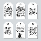 Christmas and New Year gift tags. Cards xmas set. Hand drawn elements. Collection of holiday paper label in black and. White. Seasonal badge sale design Stock Image