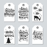Christmas and New Year gift tags. Cards xmas set. Hand drawn elements. Collection of holiday paper label in black and. White. Seasonal badge sale design Stock Images