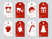 Christmas and New Year gift tags. Cards xmas set. Hand drawn elements. Collection of holiday paper label in red and. White. Seasonal badge sale design. Texture royalty free illustration