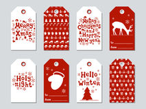 Christmas and New Year gift tags. Cards xmas set. Hand drawn elements. Collection of holiday paper label in red and Stock Photos