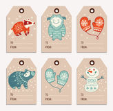 Christmas and New Year gift tags, stickers, labels. Vector Christmas labels collection with badger, cute bear, yeti, snowman and mittens. Holiday decoration Stock Images