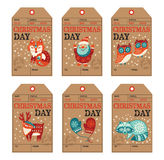 Christmas and New Year gift tags, stickers, labels. Vector Christmas labels collection with santa claus, cute fox, owls, deer, raccoon and mittens. Holiday Royalty Free Stock Photography