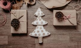 Christmas or New year gifts. Holiday decor concept.Toned picture. Top View. Small white Christmas tree with Christmas or New year gifts. Holiday decor concept royalty free stock photo