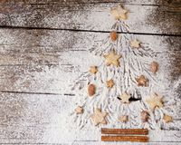 Christmas or New Year gingerbread cookies, space for text, recipe. Christmas or New Year gingerbread cookies laid out on the flour as a Christmas tree, space for Stock Photo