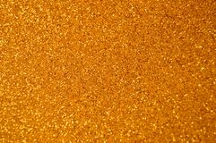 Christmas New Year Gold Glitter background. Holiday abstract texture fabric stock photos