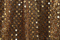 Christmas New Year Gold Glitter background. Holiday abstract texture fabric Royalty Free Stock Photo
