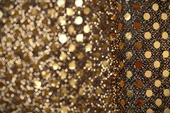 Christmas New Year Gold Glitter background. Holiday abstract texture fabric Royalty Free Stock Photos