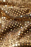 Christmas New Year Gold Glitter background. Holiday abstract texture fabric Stock Image