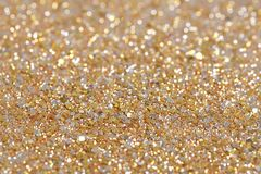 Christmas New Year Gold and Silver Glitter background. Holiday abstract texture Royalty Free Stock Photos