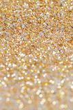 Christmas New Year Gold and Silver Glitter background. Holiday abstract texture Royalty Free Stock Image