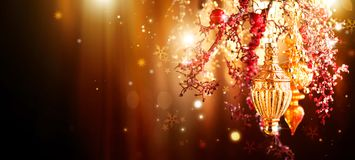 Christmas and New Year golden decorations. Blinking holiday background Stock Image