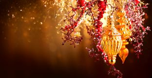 Christmas and New Year golden decorations. Blinking holiday background Royalty Free Stock Image