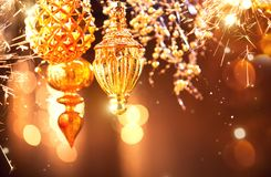 Christmas and New Year golden decorations. Blinking holiday background Stock Photos