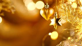 Christmas and New Year golden decorations. Abstract holiday background Stock Photo
