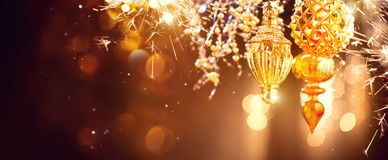 Christmas and New Year golden decorations. Blinking holiday background Stock Photography