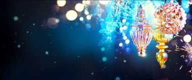 Christmas and New Year golden decorations over blinking night background Stock Images