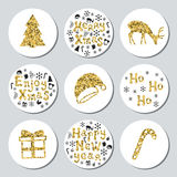 Christmas New Year golden gift round stickers. Labels xmas set. Hand drawn glitter decorative element. Collection of Royalty Free Stock Image