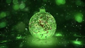 Christmas Green Ice Glass Bauble Decoration snow colorful petals background loop