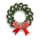 Christmas, New Year. Green spruce branch. Christmas wreath with shadow and snow. Red onions, silver balls on a white Stock Photo