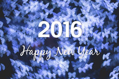 Christmas and New Year greeting card on blue butterfly light bokeh. Background, 2016 Royalty Free Stock Images