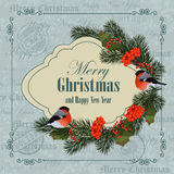 Christmas and New Year greeting card. Bullfinches, pine branches and ash berries. Vintage postcard background Royalty Free Stock Photos