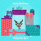 Christmas and New Year Greeting card. Deer head with gifts Stock Photos