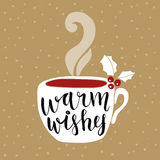 Christmas, New Year greeting card, invitation. Handwritten Warm wishes text. Hand drawn cup of tea or coffee decorated by holly. Berries. Vector illustration Royalty Free Stock Photo