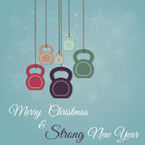 Christmas and New Year greeting card with kettlebells. Vector vintage Christmas and New Year greeting Card. Greeting card with ketllebells stylized like royalty free illustration