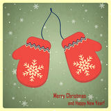 Christmas and New Year greeting card with mittens Stock Images