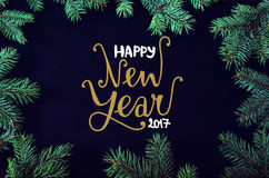 Christmas and New Year greeting card with spruce tree brunches frame and hand dr Royalty Free Stock Images