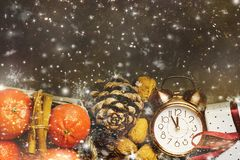 Christmas New Year Greeting Card Tangerines in Basket Alarm Clock Pine Cones Gift Box Snow Flakes Stock Photography