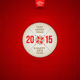 Christmas and New year greeting label. Christmas and 2015 New year greeting label on a red knitted background Royalty Free Illustration