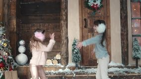 Christmas or New Year. happy children throw up snow. the children enjoy the Christmas holidays. Two little girls on the. Christmas or New Year. Children in light stock footage
