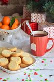 Christmas and new year holiday celebration concept background. Mug of mulled wine with spices, homemade nut cookie, shortbread, xm. As tree decoration on wooden stock images