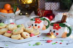 Christmas and new year holiday celebration concept background. Mug of mulled wine with spices, homemade nut cookie, shortbread, xm. As tree decoration on wooden stock photos