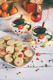 Christmas and new year holiday celebration concept background. Mug of mulled wine with spices, homemade nut cookie, shortbread, xm. As tree decoration on wooden royalty free stock photo