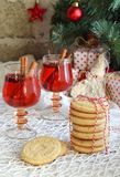 Christmas and new year holiday celebration concept background. Mug of mulled wine with spices, homemade nut cookie, shortbread,. Xmas tree decoration on wooden stock photos