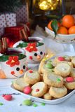 Christmas and new year holiday celebration concept background. Mug of mulled wine with spices, homemade nut cookie, shortbread,. Xmas tree decoration on wooden stock images